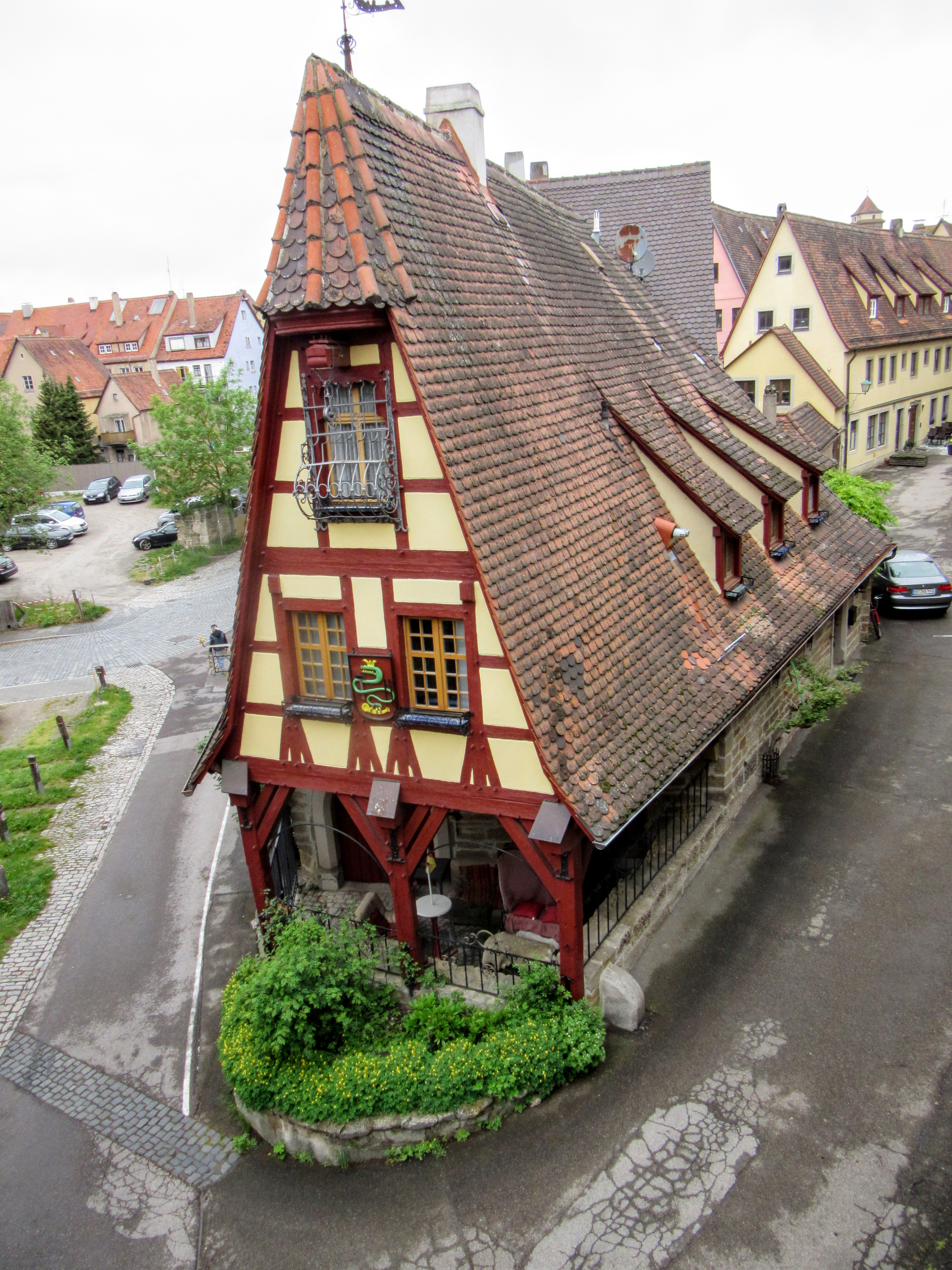A red and yellow half-timbered house. | Walking Along the Wall of Rothenburg ob der Tauber.