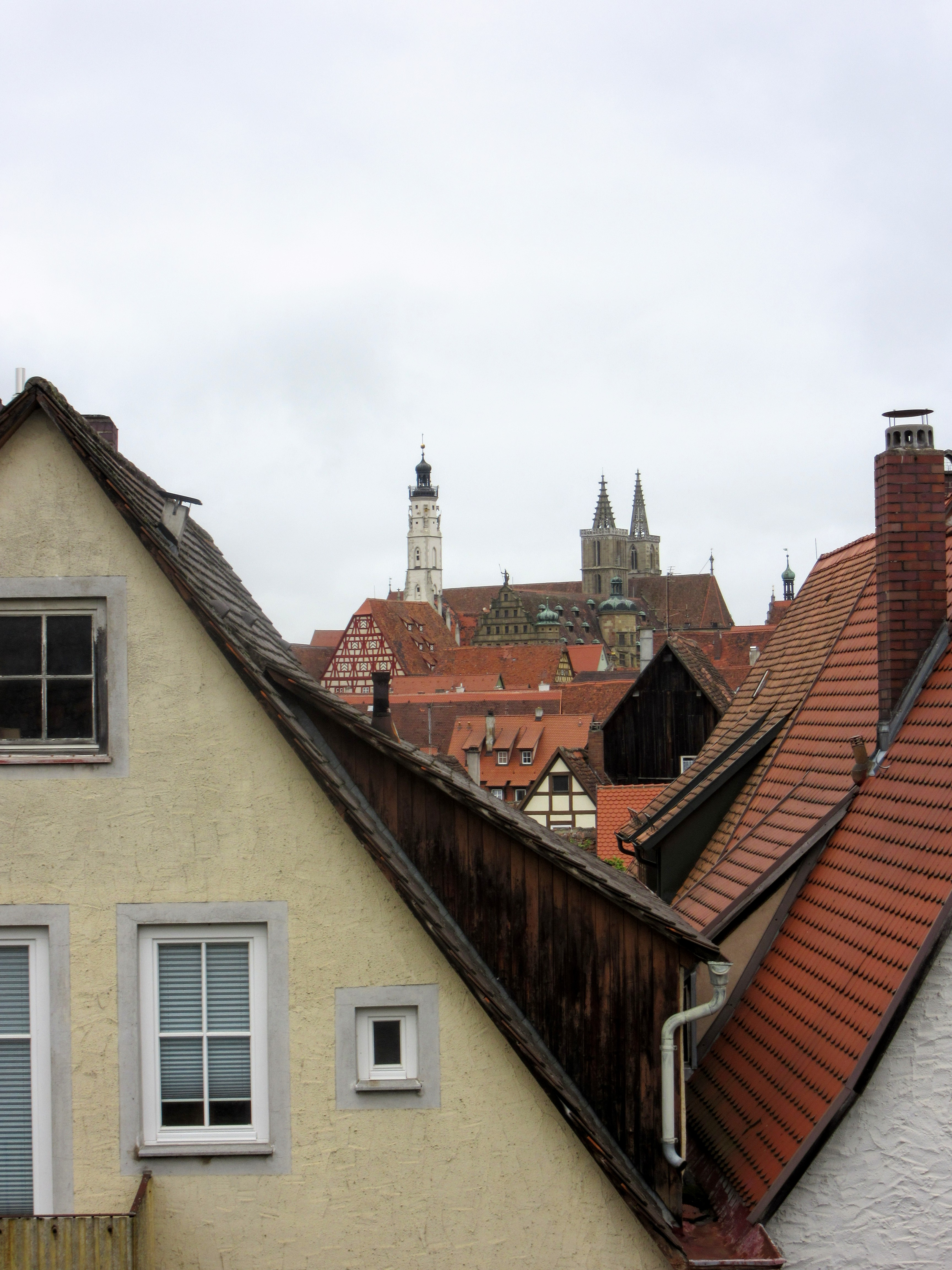 City center seen between the roof tops. | Walking Along the Wall of Rothenburg ob der Tauber.