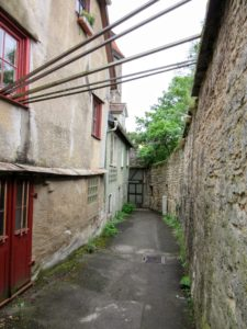 Between the city wall and a row of homes. | Walking Along the Wall of Rothenburg ob der Tauber.