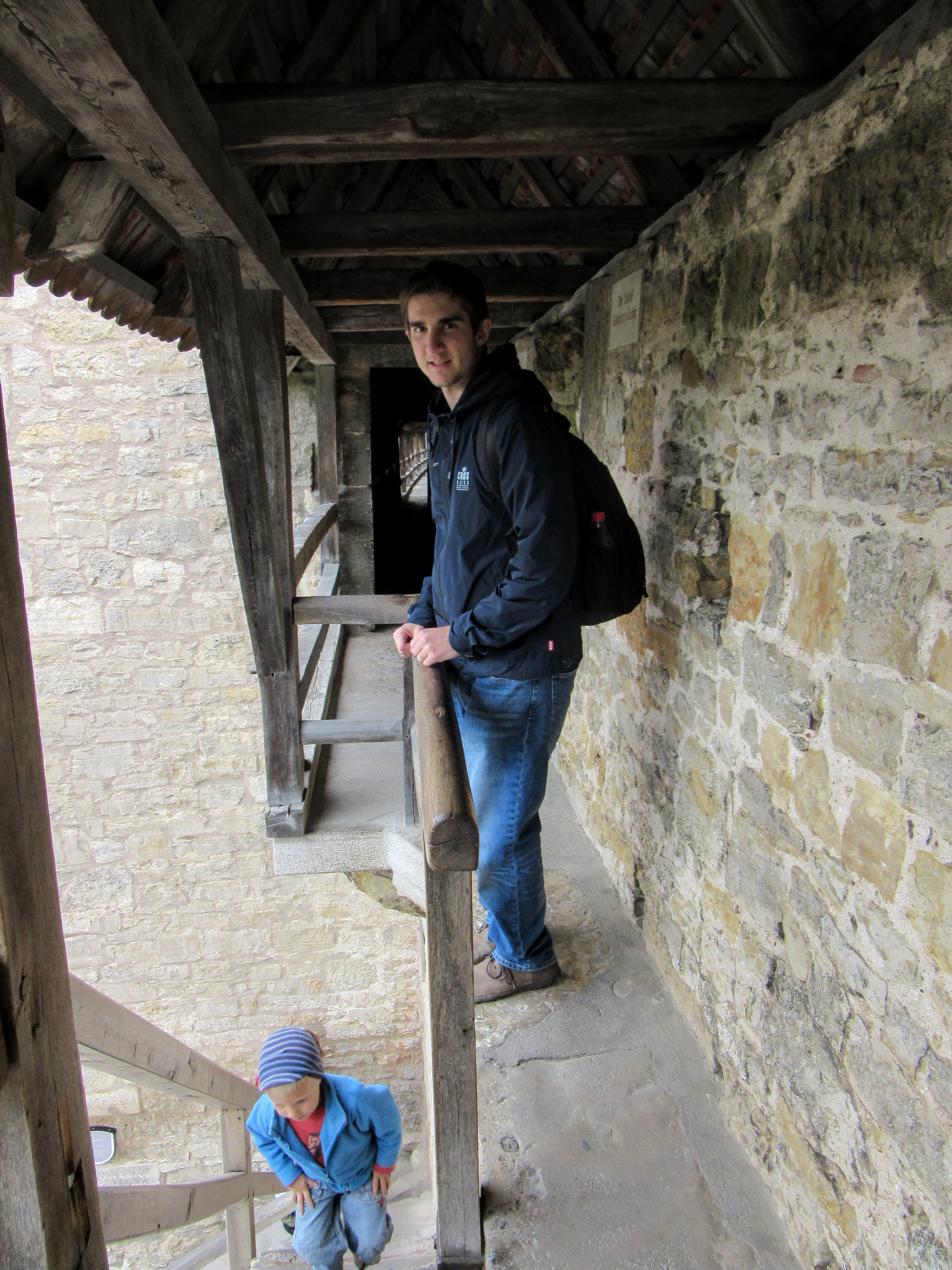 Mr. Meena in a narrow gap along the path. | Walking Along the Wall of Rothenburg ob der Tauber.