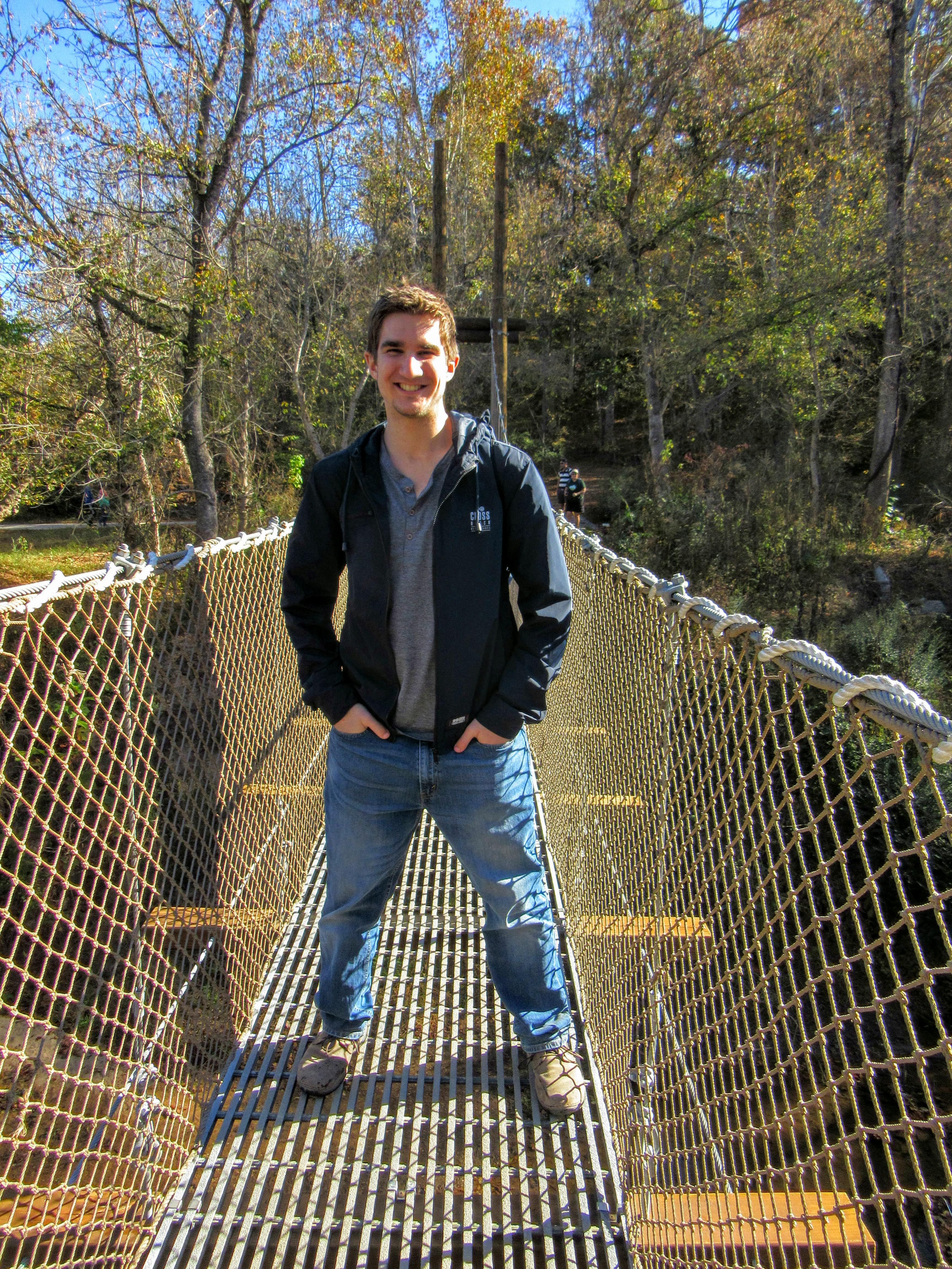 Mr. Meena on the suspension bridge. | Hiking in Shelby, North Carolina: the First Broad River Trail.