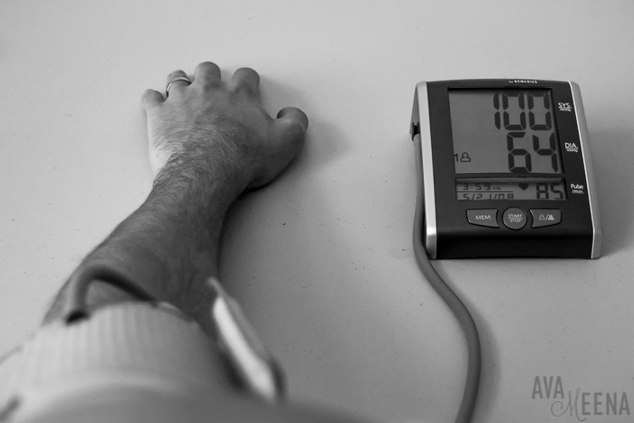 My husband using my blood pressure monitor. | Going through the depths of my sickness with lupus.