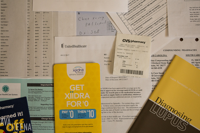 Various healthcare paperwork. | 10 Things I Didn't Realize Would Happen After I Was Diagnosed with Lupus.